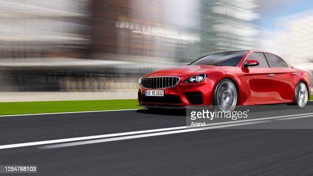 car driving on a road - sedan stock pictures, royalty-free photos & images