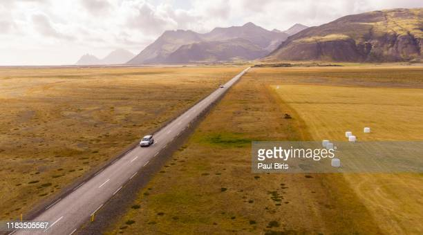 car driving on beautiful scenic road in iceland - 荒野 ストックフォトと画像