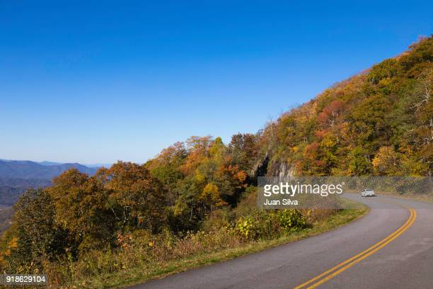 car driving on blue ridge parkway - blue ridge parkway stock pictures, royalty-free photos & images