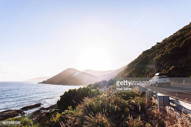 car driving on coastal road - driver stock pictures, royalty-free photos & images