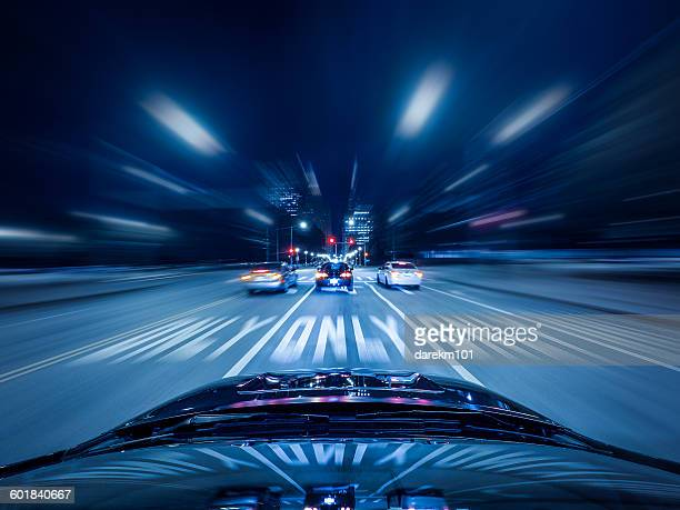 Car driving on highway at night, Chicago, Illinois, America, USA