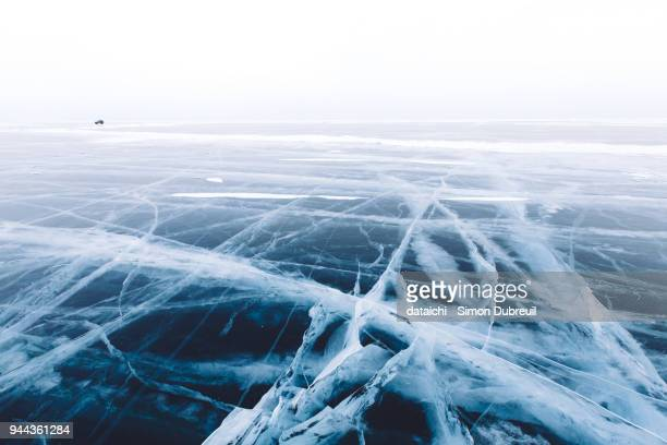 car driving on lake baikal - frozen foto e immagini stock