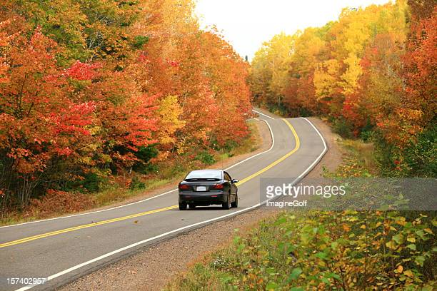 car driving on remote appalachian highway in fall - hybrid car stock photos and pictures