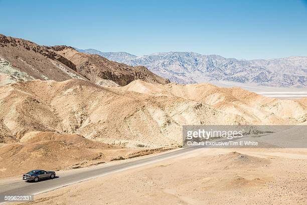 Car driving on road through Death Valley, California, USA