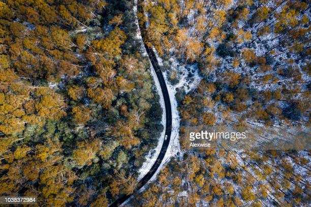 car driving on snow road aerial - melbourne australia stock pictures, royalty-free photos & images