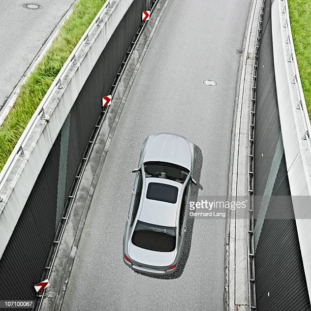 Car driving on street, elevated view