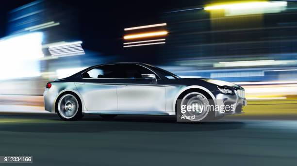 car driving on urban road - cars stock photos and pictures