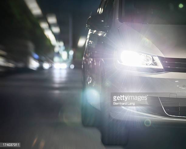 Car driving on urban street by night