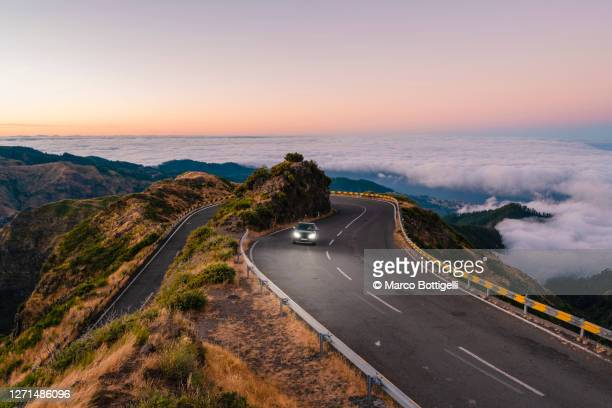 car driving on winding mountain road, madeira island, portugal - clear sky stock pictures, royalty-free photos & images