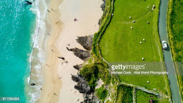 car driving past coumeenoole bay - ireland stock pictures, royalty-free photos & images