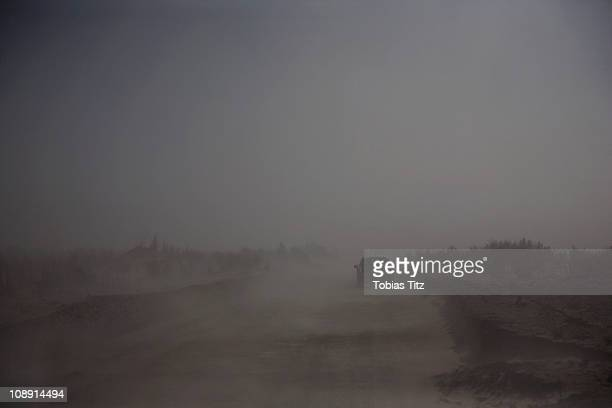 a car driving through fog in the atacama desert, chile - ominous stock photos and pictures