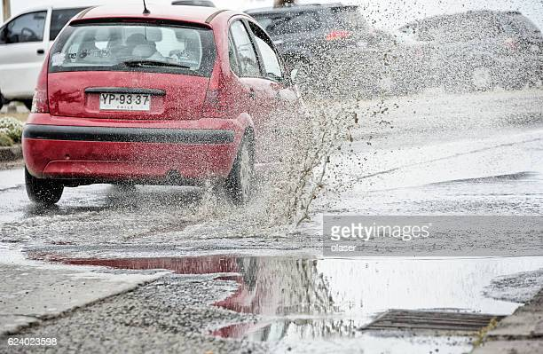Car driving through puddle