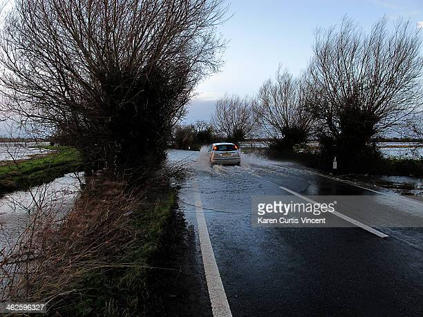 Car driving through the floods on the Somerset Levels