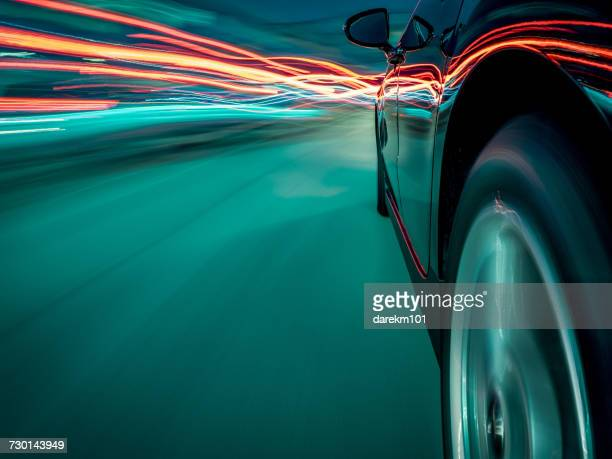 car driving through traffic - light trail stock photos and pictures