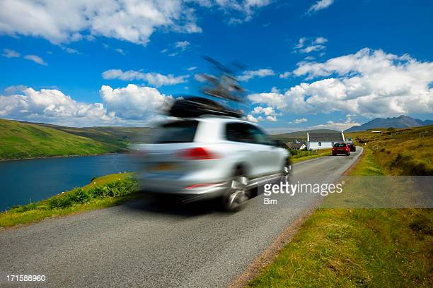 car driving with bike on roof, isle of skye, scotland, - country road stock photos and pictures