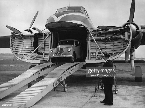 A car emerges from the Bristol 170 Freighter at Le Touquet after an experimental flight from Birmingham