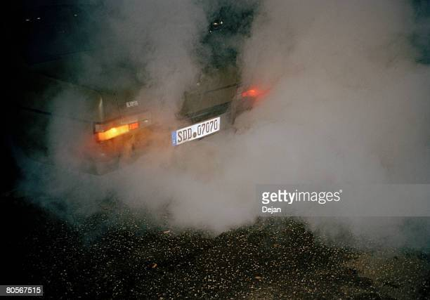 A car emitting fumes