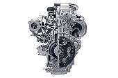 Car engine in front of white background