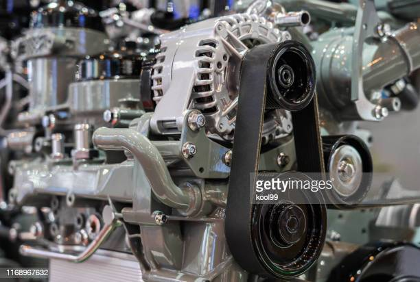 car engine partial close-up - silver belt stock pictures, royalty-free photos & images