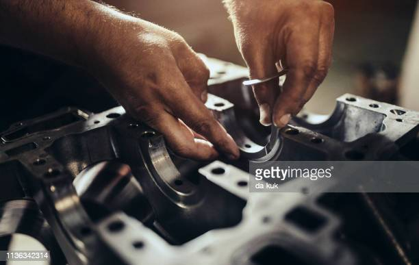 car engine repair - electric motor stock photos and pictures