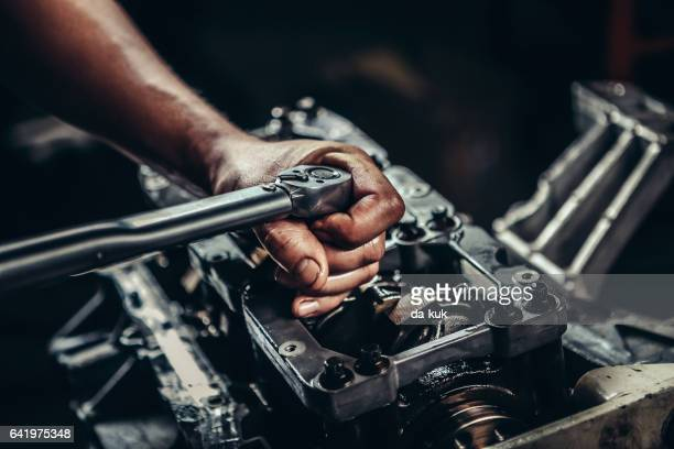 v8 car engine repair - suspension bridge stock photos and pictures