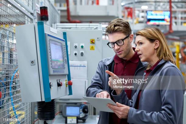 car engineers with tablet computer looking away - plant stock pictures, royalty-free photos & images