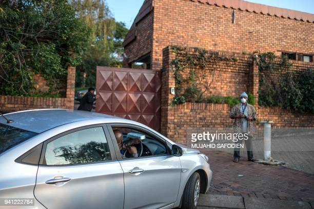 A car enters early morning on April 3 2018 the house of late South African antiapartheid campaigner Winnie MadikizelaMandela exwife of former South...