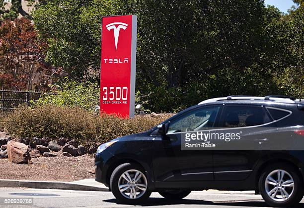 A car enters Tesla Motors Inc headquarters in Palo Alto CA on July 23 2014 Tesla Motors is the maker of highend electric cars