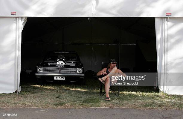 A car enthusiast and his vehicle sit in a garage during Street Machine Summernats 21 Car Festival at Epic Park on January 5 2008 in Canberra...
