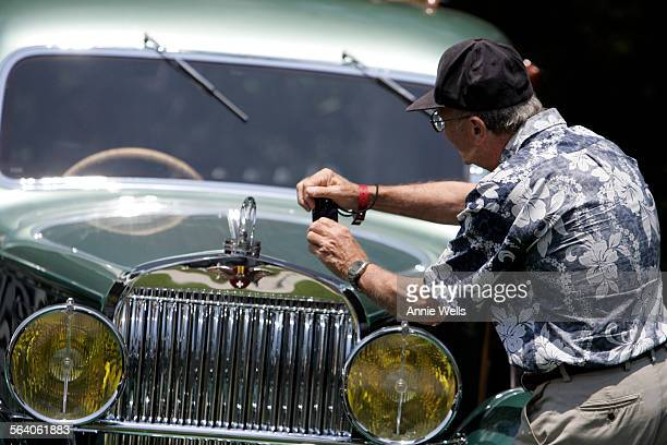 Car enthusiast chip Worsinger of Burbank snaps a picture of a Woodie called 1937 Hispano Suiza Shooting Brake owned by Peter Mullin of Los Angeles...