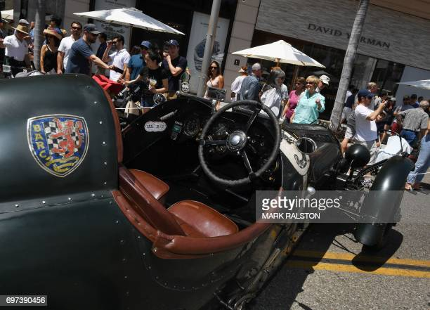 Car enthusiasts look at a 1928 Bentley 3/8 litre racer on display at the Rodeo Drive Concours Delegance car show in Beverly Hills California on June...