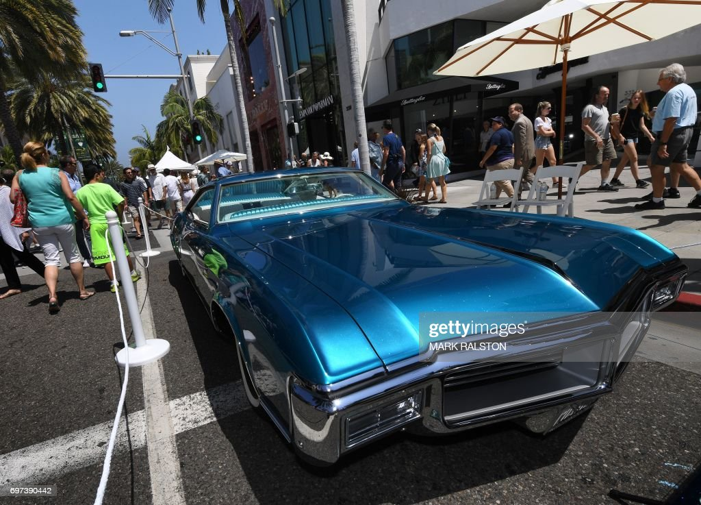 Car Enthusiasts Look At A Buick Riviera Custom Car On Display - Beverly hills car show