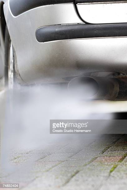 Car exhaust pumping out of fumes, close-up