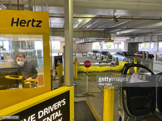 Car exiting the empty car rental area at Hertz«s Car Rental Parking area at Miami International Airport