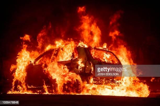 A car explodes into flames as the Camp fire tears through downtown Paradise California on November 8 2018 A rapidly spreading lateseason wildfire in...
