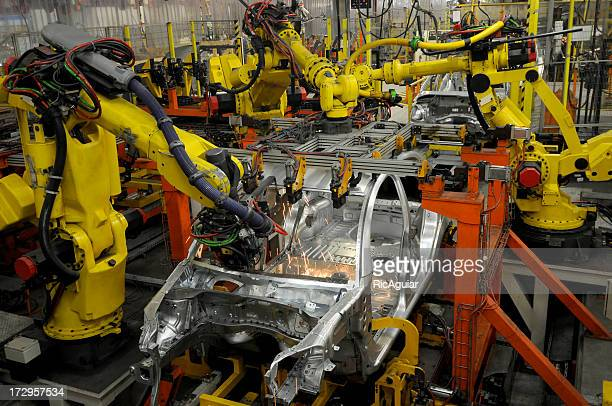 Car factory building new vehicles with robotic arms