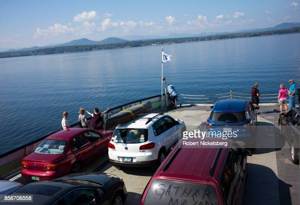 Car ferry passengers stand near the bow while crossing Lake Champlain from Charlotte Vermont to heading west to Essex New York September 25 2017 Lake...