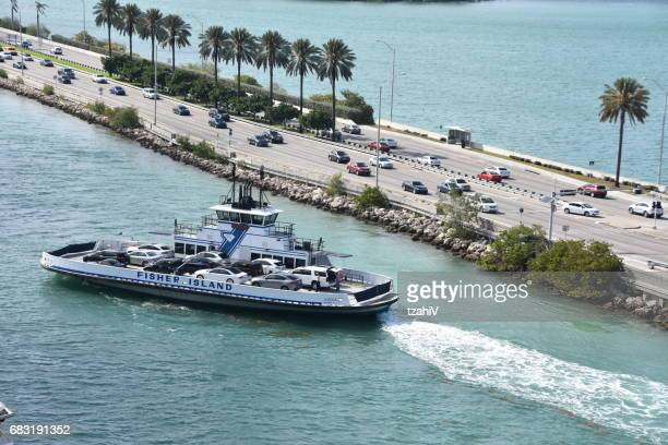 car ferry shuttle from fisher island to miami port - fisher island stock pictures, royalty-free photos & images