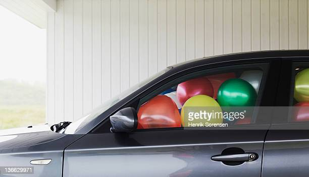 Car filled with ballons