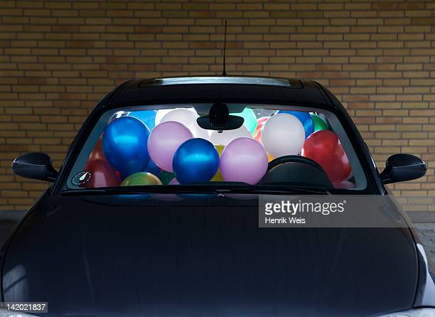 car filled with colorful balloons - anniversary stock pictures, royalty-free photos & images