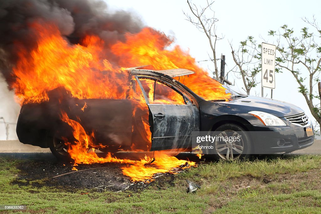 Car fire, burning profusely on New Jersey highway : Stock Photo
