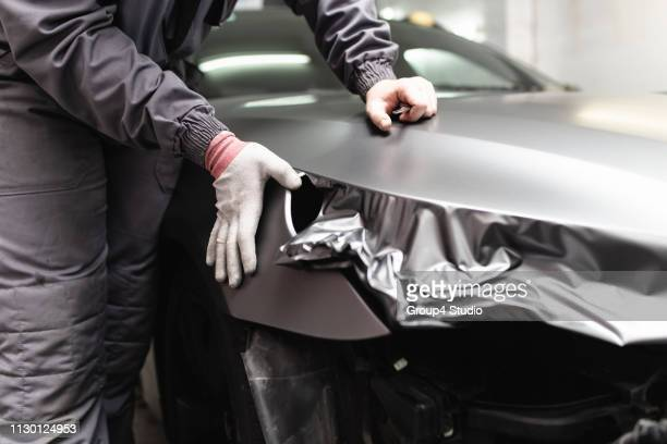 car foil - man wrapped in plastic stock pictures, royalty-free photos & images