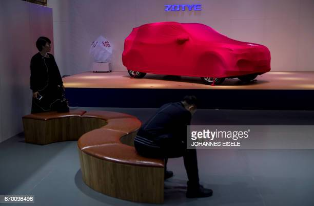 A car from Chinese car maker Zotye is covered during a media preview at the 17th Shanghai International Automobile Industry Exhibition in Shanghai on...