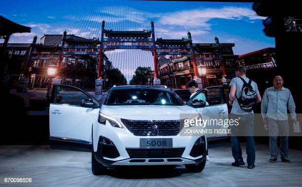 A 5008 car from French car maker Peugeot is pictured during a media preview for the 17th Shanghai International Automobile Industry Exhibition in...