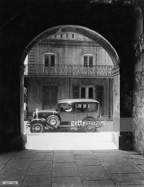 A car glimpsed through an arch of the old Cabildo in New Orleans circa 1935