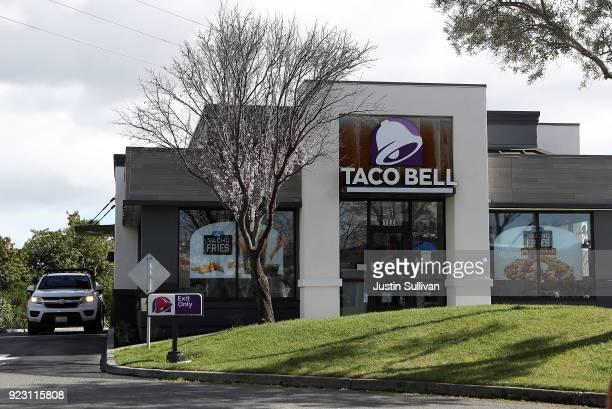 A car goes through a drive thru at a Taco Bell restaurant on February 22 2018 in Novato California Taco Bell has become the fourthlargest domestic...