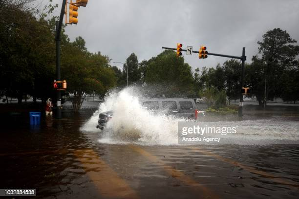 Car goes through a flooded street during the heavy rain of outer bands of Hurricane Florence in New Bern, North Carolina, United States on September...