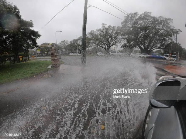 A car goes through flooding on Anzac Parade on February 09 2020 in Sydney Australia The Bureau of Meteorology has forecast heavy rainfall across...