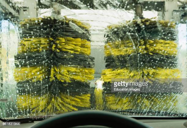 Car going through car wash photographed from inside vehicle