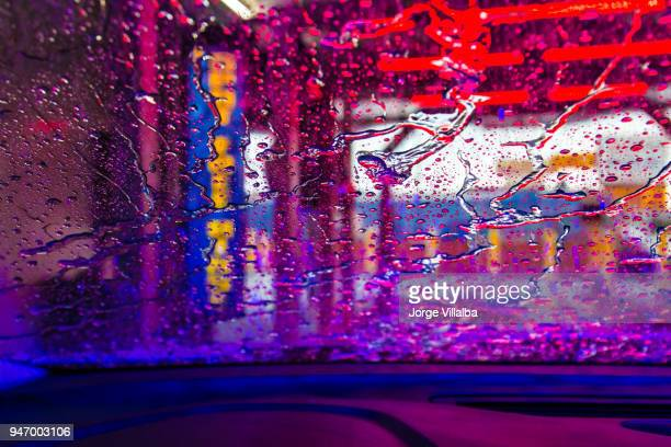 car going through car wash - car wash stock photos and pictures
